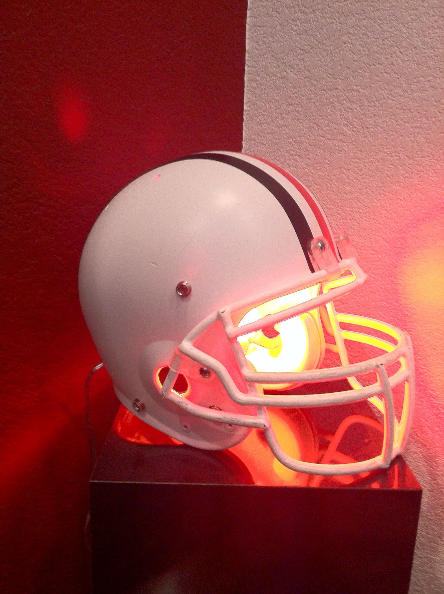 Repurposed helmet light. My husband repainted and decorated this ...