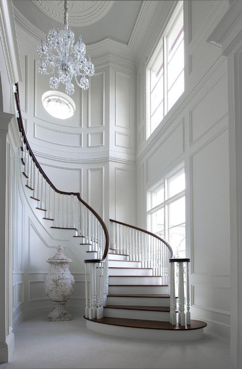 Formal Entry @ 2 Story Spiral Staircase U0026 White Panel Walls