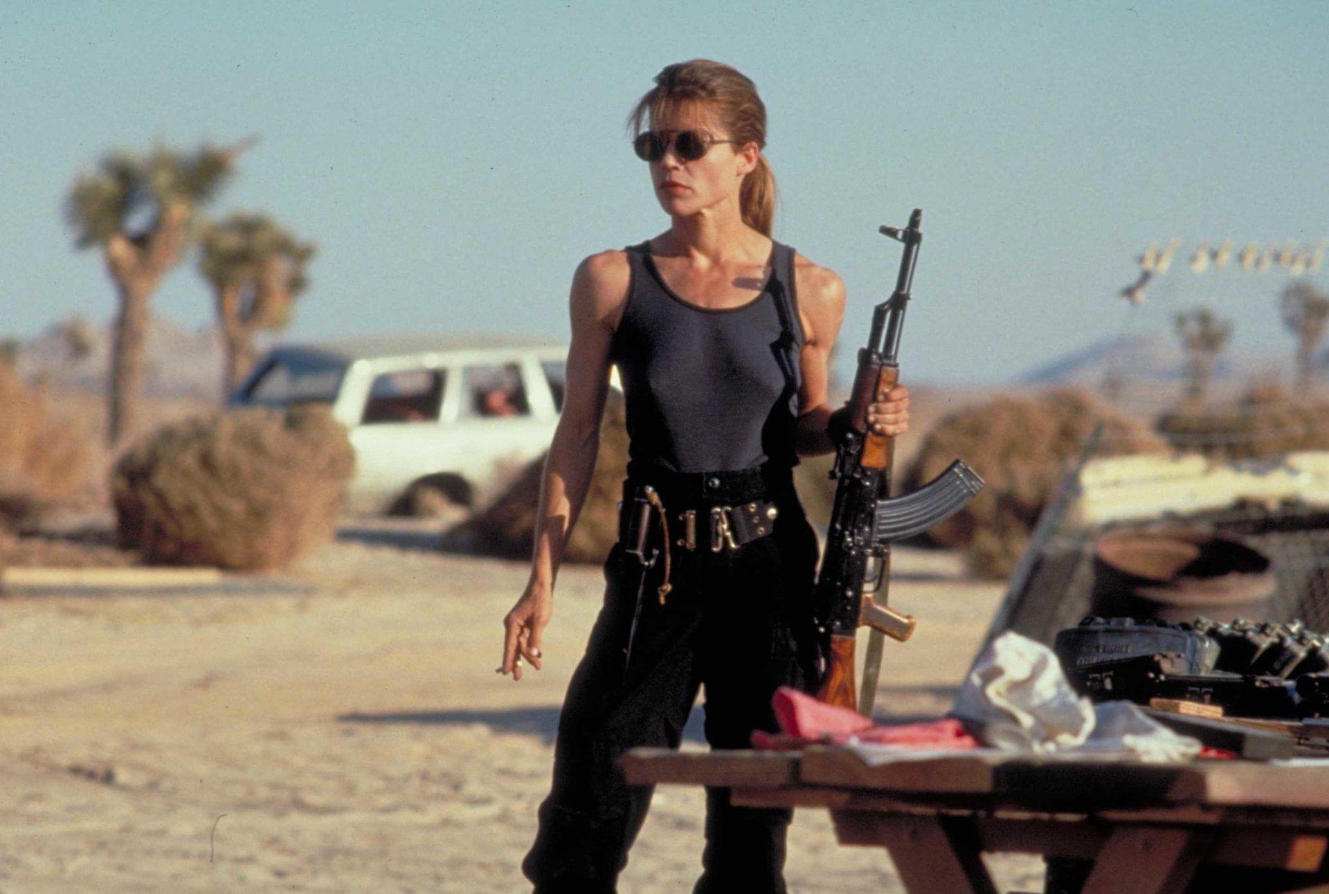Women S Black Tank Top Terminator Terminator 2 Judgment Day Linda Hamilton Sarah Connor 1080p Wallpa Linda Hamilton Terminator Terminator Terminator Movies