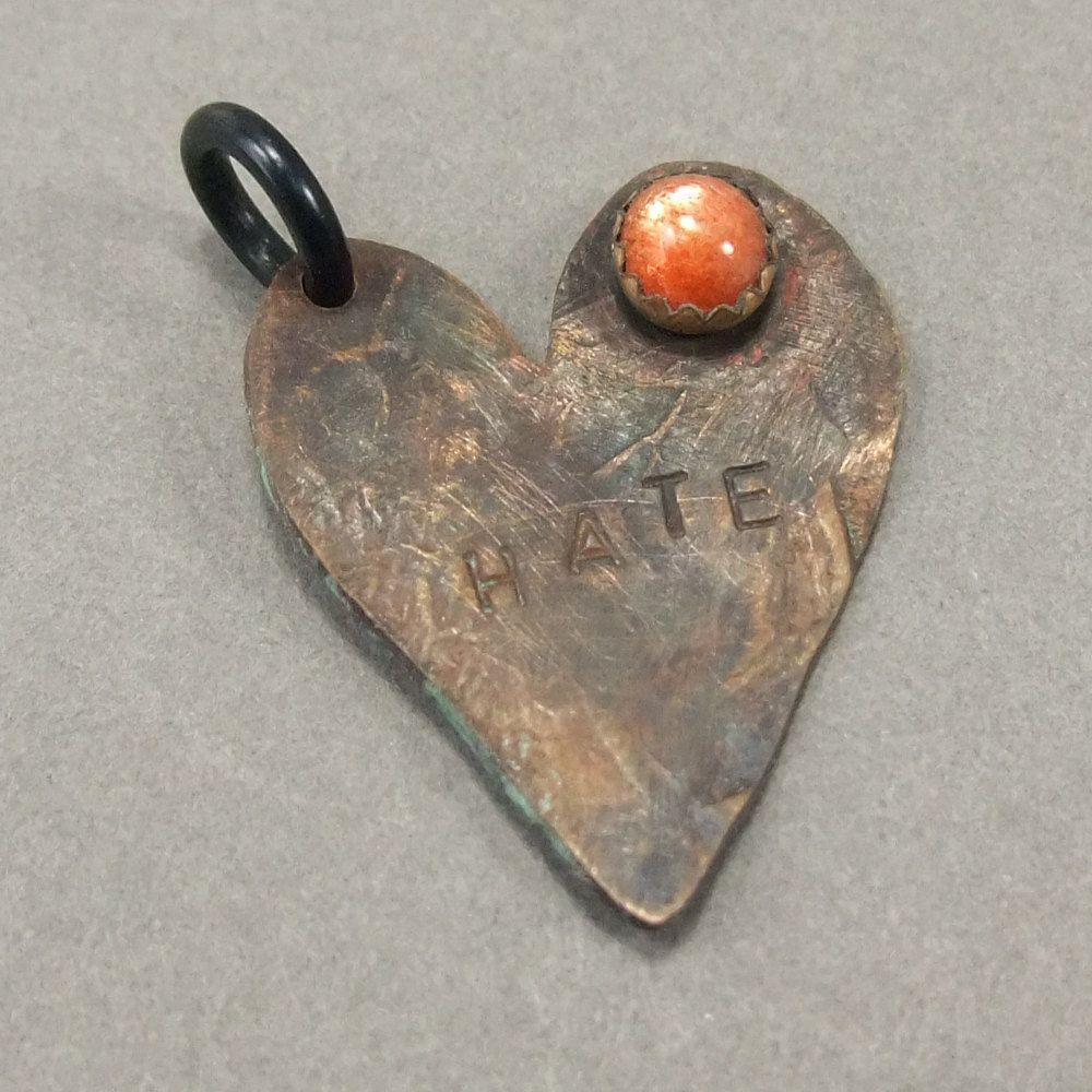 CS5 Heartbreak Charm with Sunstone by AndesCruz. $42,00, via Etsy.