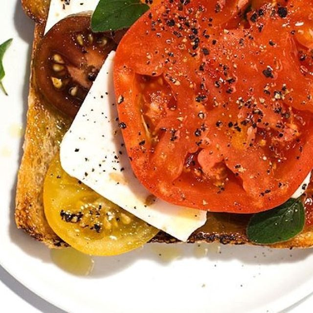 "Open faced heirloom, feta, and basil ""sandwich"" with kalamta olive emulsification"