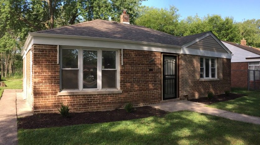 This beautiful single family brick home was built in 1946