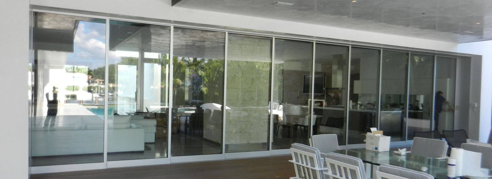 Fleetwood Impact Sliding Doors In Unlimited Widths Panels Up To 5 X 12 Open Double Corners Aluminium Windows And Doors Glass Garage Door Sliding Glass Door