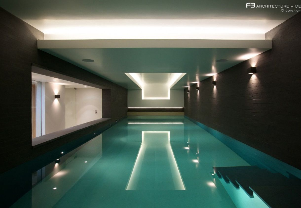 Delightful Indoor Swimming Pool Design Idea With Blue Pool Water ...