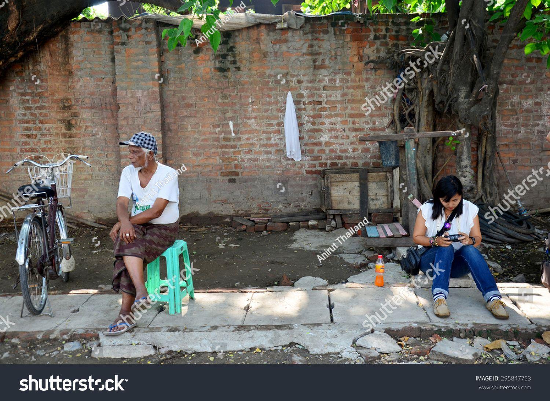 MANDALAY, MYANMAR - MAY 23 : Burmese people and Thai women wait bus at bus station on May 23, 2015 in Mandalay, Myanmar. #Sponsored , #AD, #Burmese#people#Thai#MANDALAY