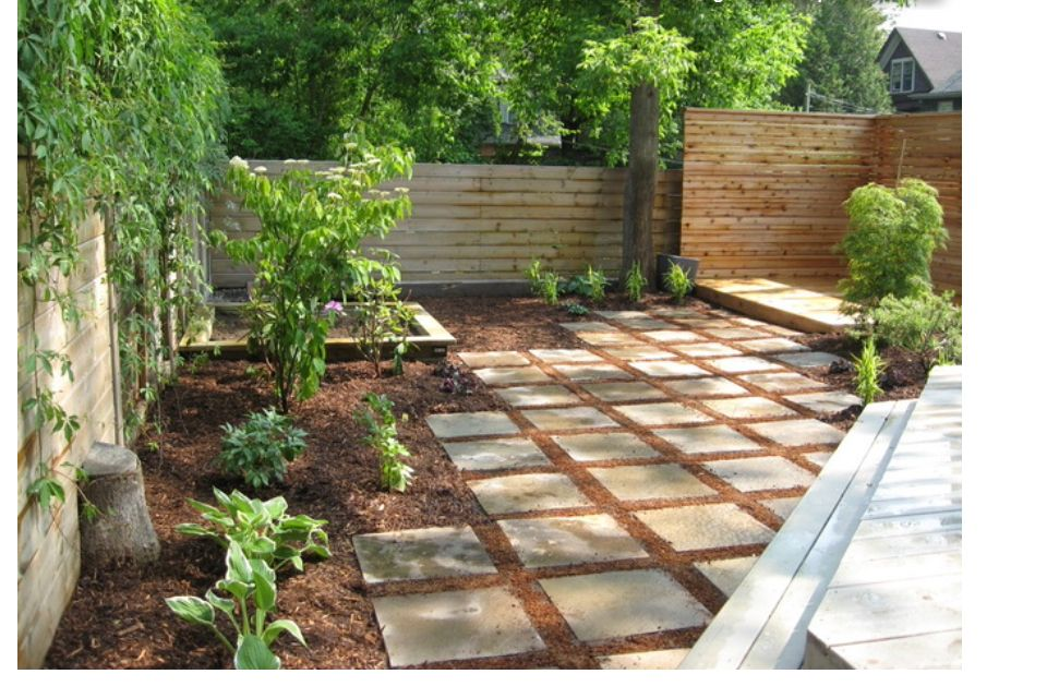 Large pavers with bark fill | Small backyard landscaping ...