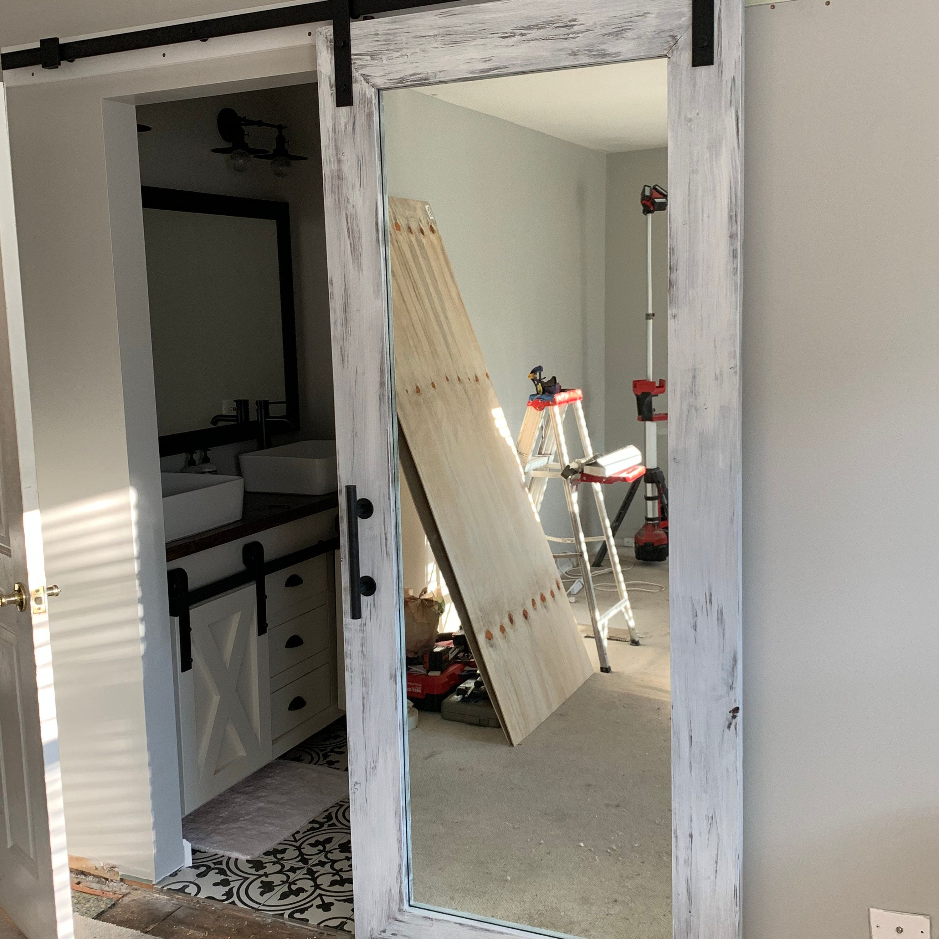 Distressed White Rustic Mirrored Sliding Barn Door Full Etsy Rustic Mirrors Interior Barn Doors Barn Door Entertainment Center