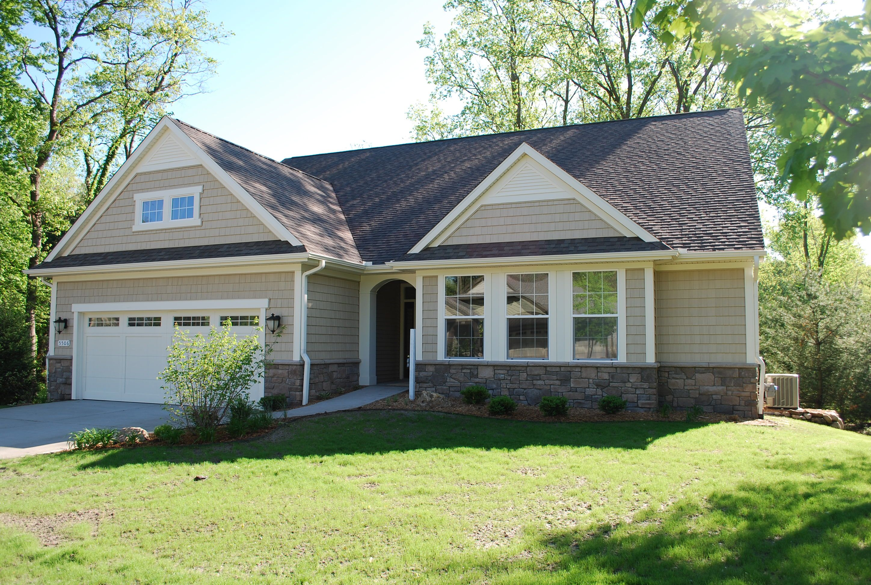 Best The Exterior Of This Home Includes Vinyl Shake Siding 400 x 300