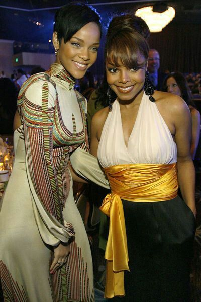 Rihanna and Janet Jackson. It must feel amazing for Rihanna standing next to someone she was inspired by and looked up to. They both have beautiful smiles!