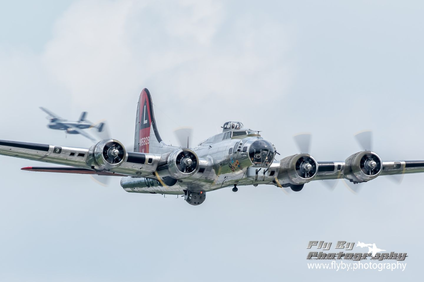 "The Yankee Air Museum's B-17 ""Yankee Lady"" followed by their B-25 ""Yankee Warrior"" making passes over the Mid-Atlantic Air Museum's World War II Weekend."