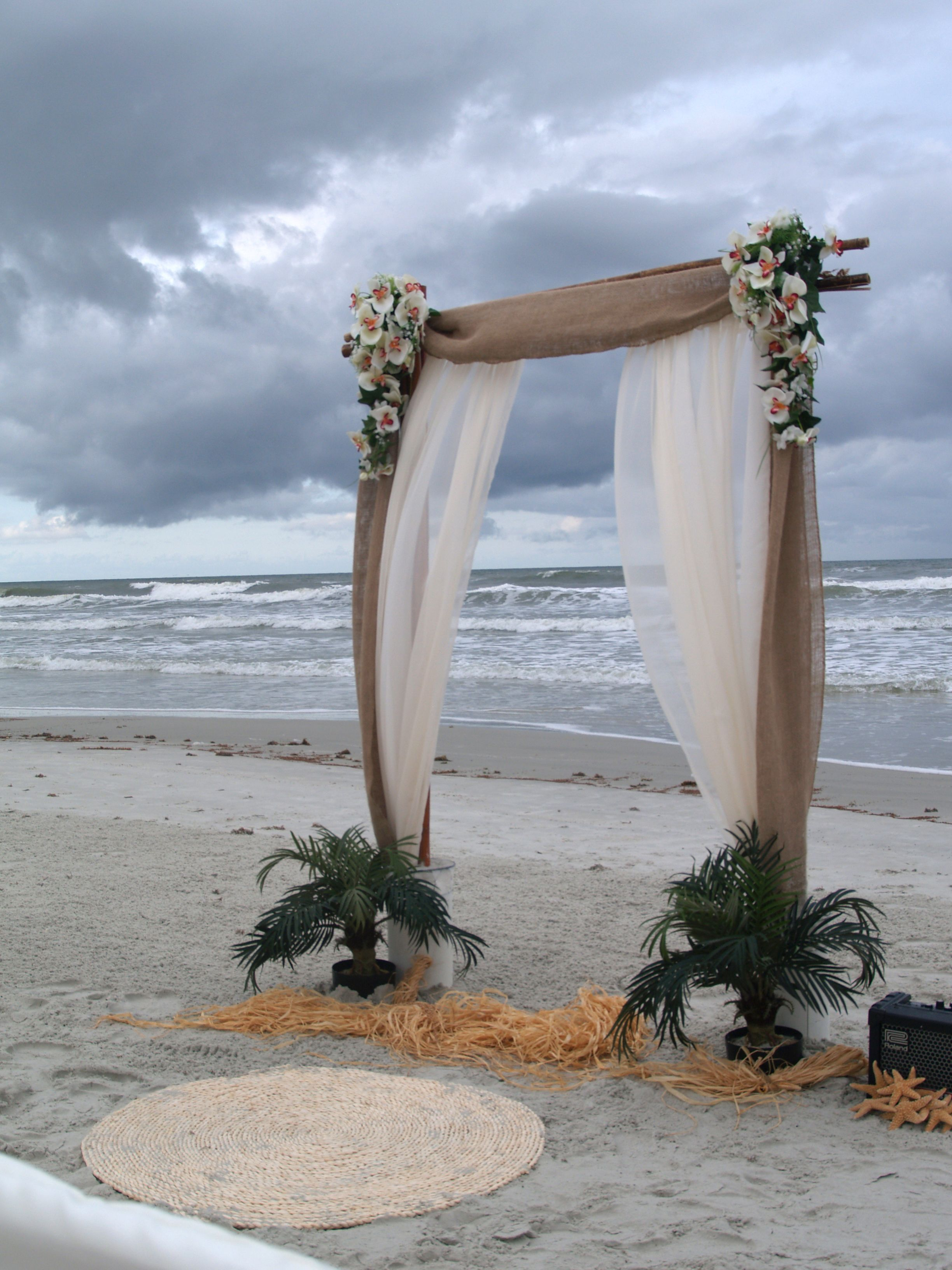 Sara two post bamboo arch with Burlap and Ivory tulle, ivory flowers