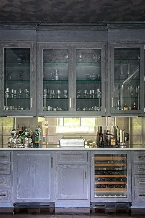 Chic Living Room Bar Features Glass Front Upper Cabinets Filled With Glass  Shelves Lined With Glassware And Gray Wire Brushed Oak Lower Cabinets  Fitted With ...