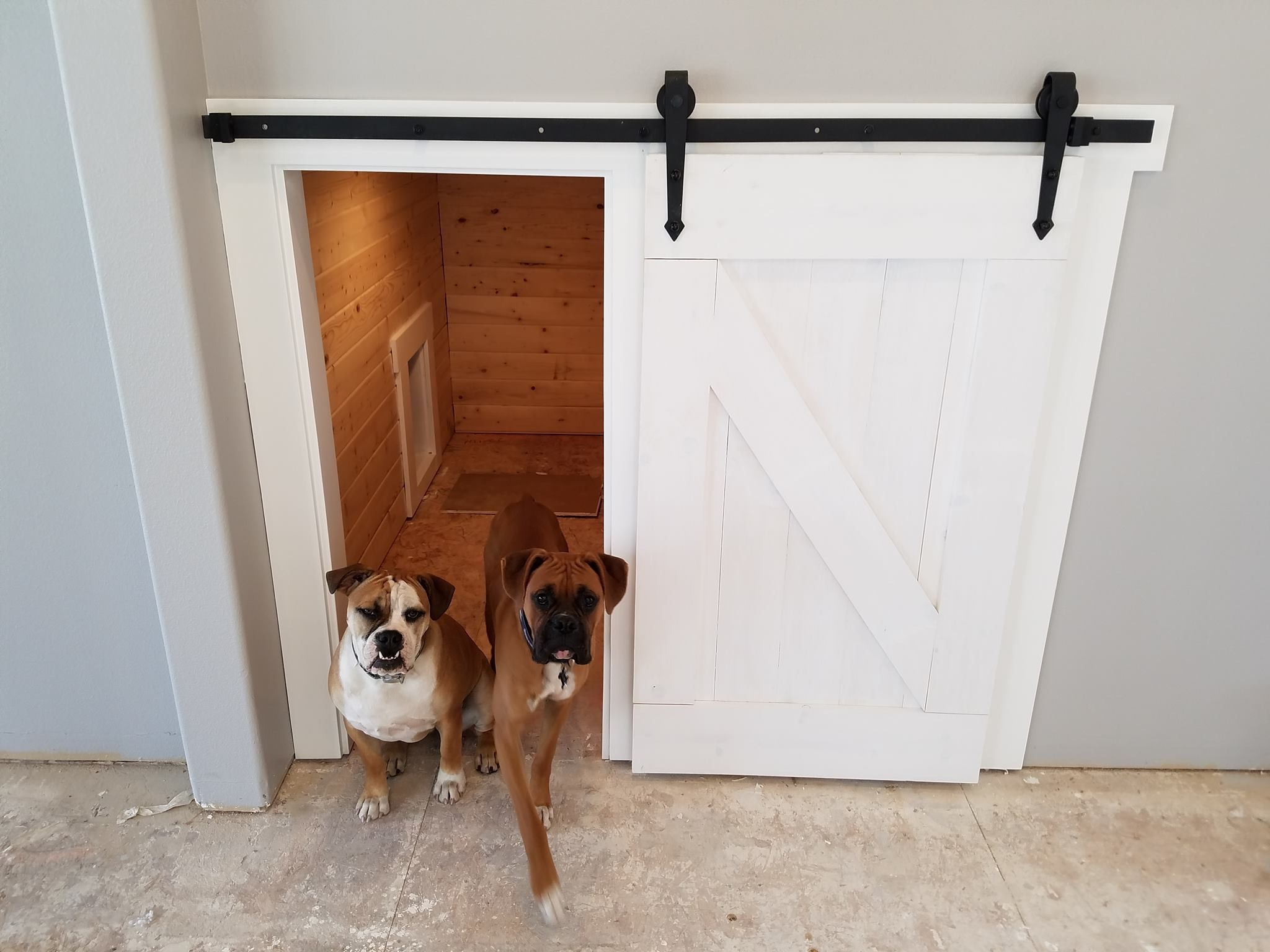 Under the stairs dog kennel with barn door...made by my