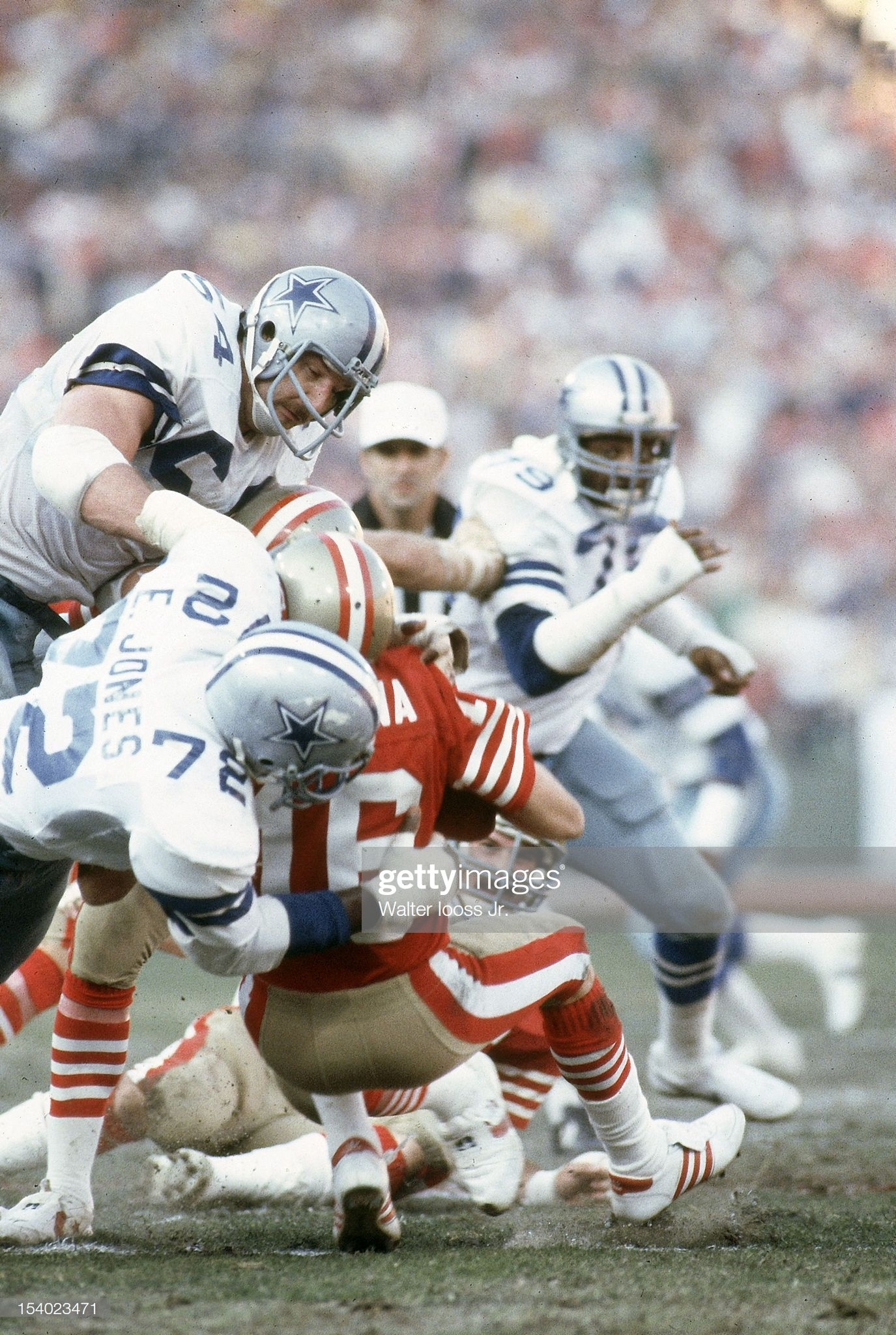 Dallas Cowboys Randy White and Ed Jones in action, making