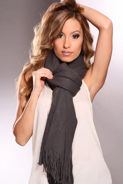 Stay knitted to perfection in this adorable scarf! Dont let a little winters chill stop you from catching up with friends over soups and salads - simply drape this soft tight knit scarf over your shoulders, and youll be comfortable enough to hang out all afternoon! Featuring a cozy soft, tight knit finish, and thin fringed edges, this accessory is sure to keep you fashionably warm all winters long
