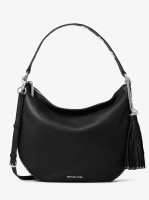 ac3b87963ef6 Michael drew inspiration from the famed free spirit of Penny Lane in  designing the Brooklyn Hobo. This modern