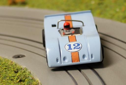 AFX Lola 260 painted and decaled in Gulf Blue Livery.  The rear deck has been filled in  and a spoiler added