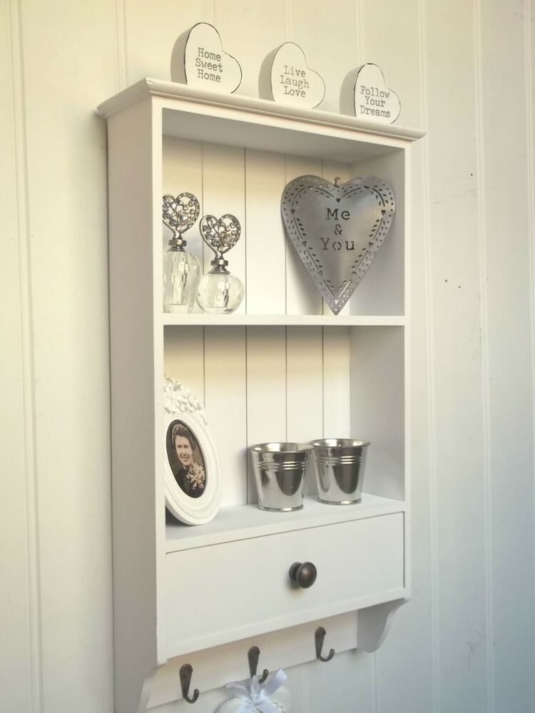 Shabby Chic White Wall Unit Display Shelf With Hooks A Charming And Useful Wall Shelf Unit In A White Painted Sh Shabby Chic Wall Unit Wall Shelf Unit Shelves