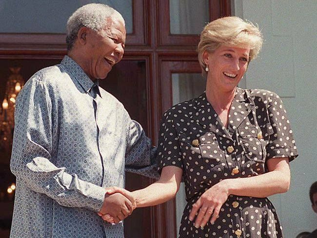 President Nelson Mandela of South Africa & Princess Diana share a very cordial moment.