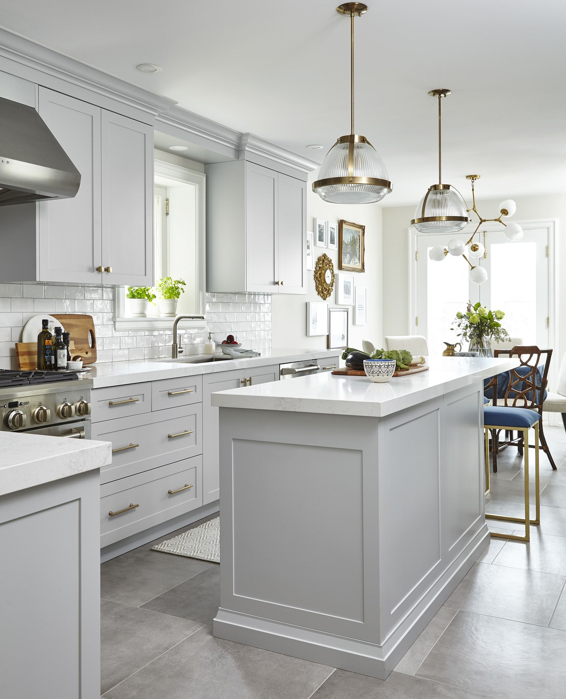 White Kitchen Cabinets With Gray Countertops: Light Grey Kitchen With Celestial Chandelier Over The