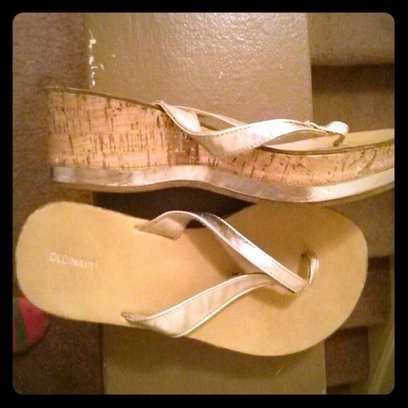Super cute metallic sandals!! Metallic and cork, only worn a few times. The size on the bottom says 5-6 but I wear a 7.5-8 and they fit me perfectly. Great with skinny jeans, leggings or dresses!! Old Navy Shoes Sandals