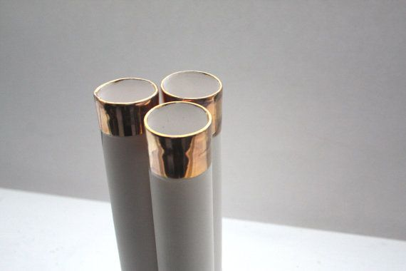 Decorative thin tall tubes made out of stoneware by madebymanos, £20.00
