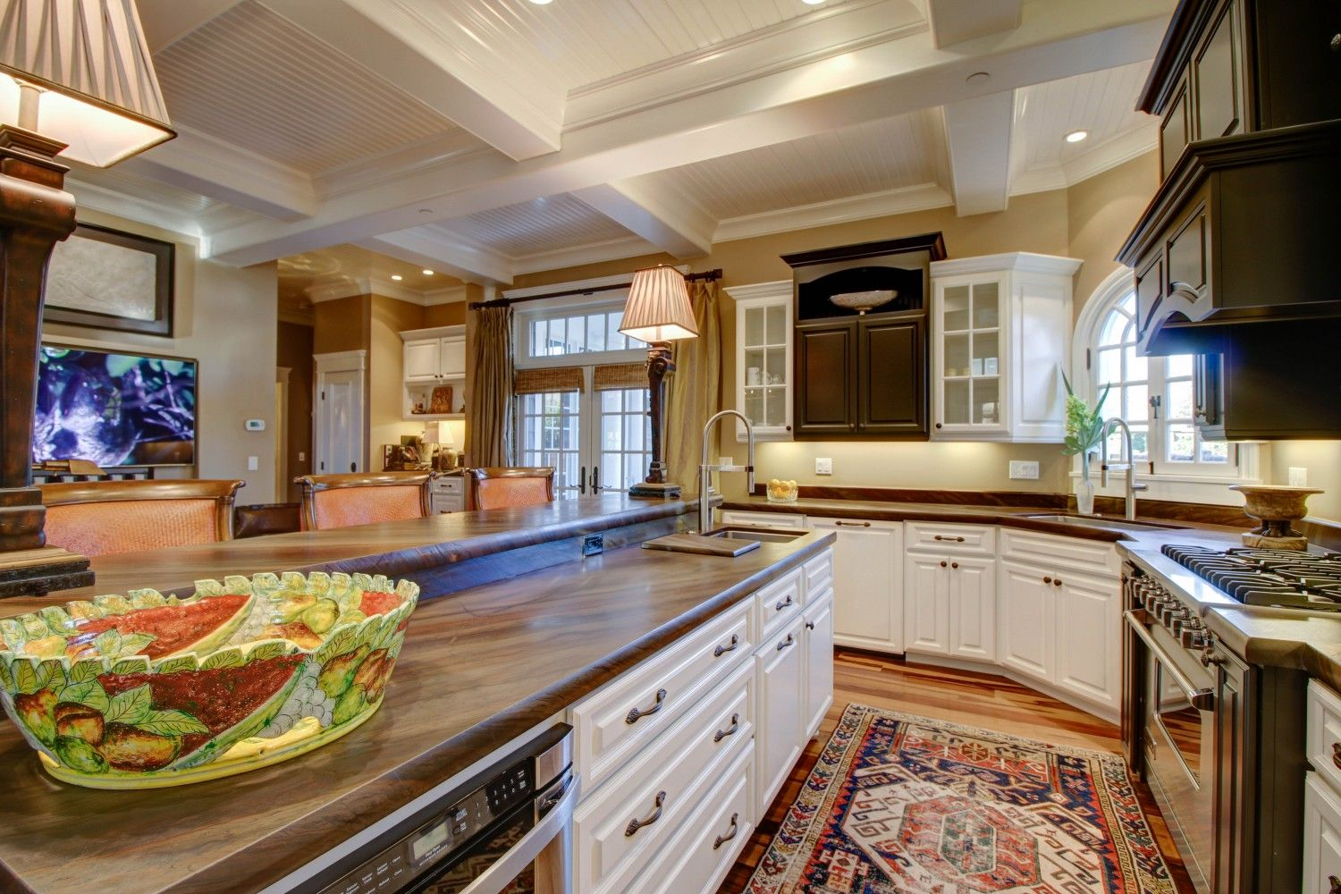The open-concept gourmet kitchen is an entertainer's dream, appointed with top-of-the-line appliances and honed granite counters with custom cabinetry.
