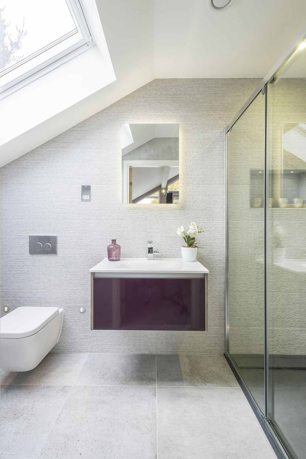 Contemporary ensuite bathroom with modern shower enclosure and velux ...