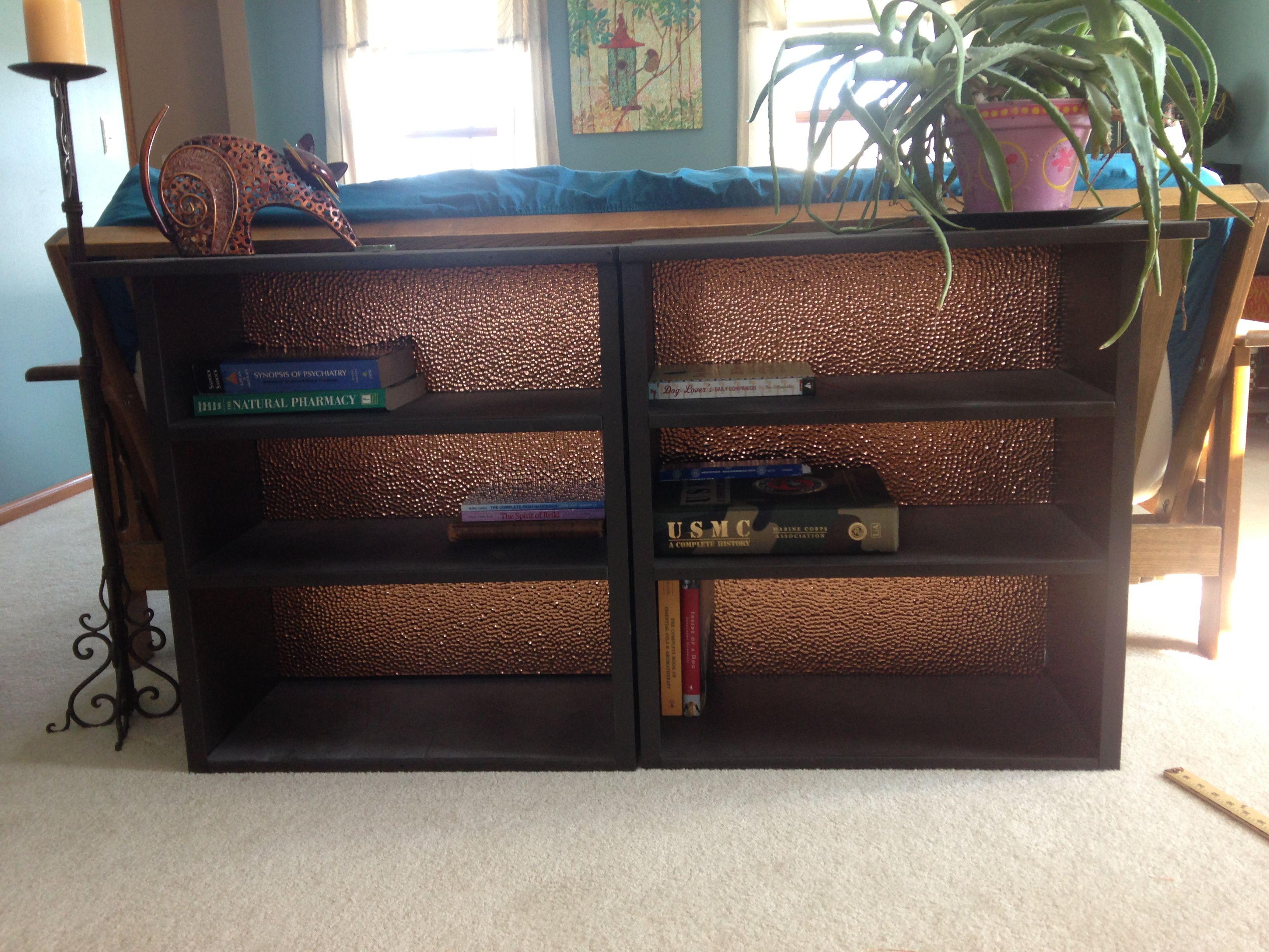 bookcase embellished with fasade backsplash panel in hammered