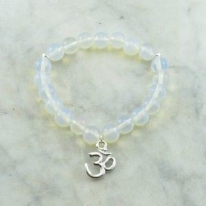 The Moon Mala Bracelet is made from 21 moonstone mala beads. A silver OM guru bead. Buddhist beads for connecting to feminine energy and power.