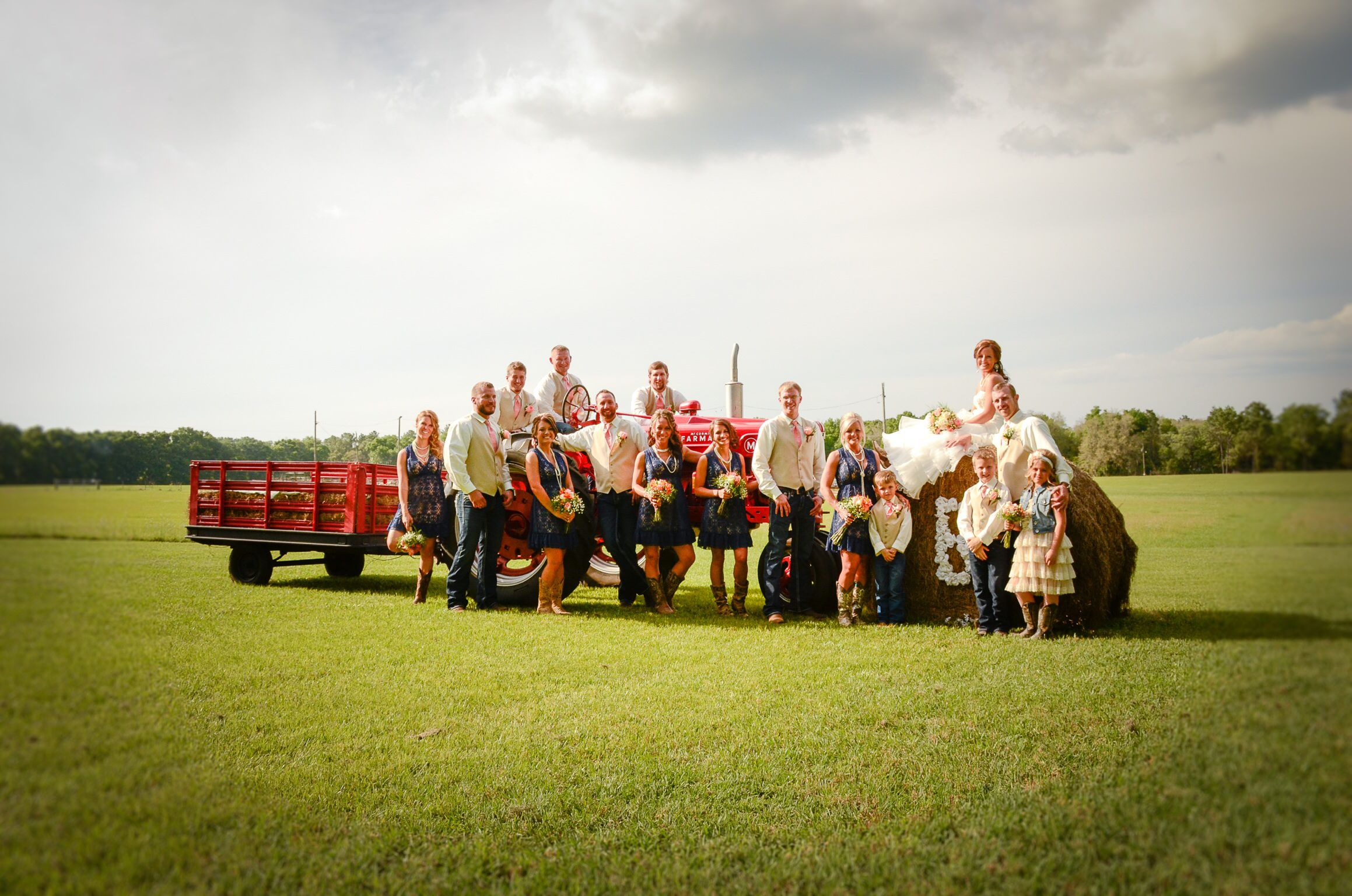 Country wedding, tractor, southern, hay bales, boots, lace