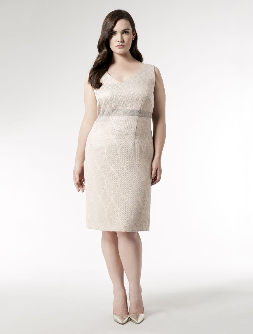 Fitted jacquard dress with back split. Knee length dress with detachable sleeves in almond motif jacquard fabric woven tiny on the bodice and giant on the skirt. A contrasting band of colour divides the weaves of bodice and skirt horizontally creating the impression of a high waistline. The dress has a deep V neck, a deep hem-to-hem back split, and is expertly fitted with darts for an exclusive tailored appearance.