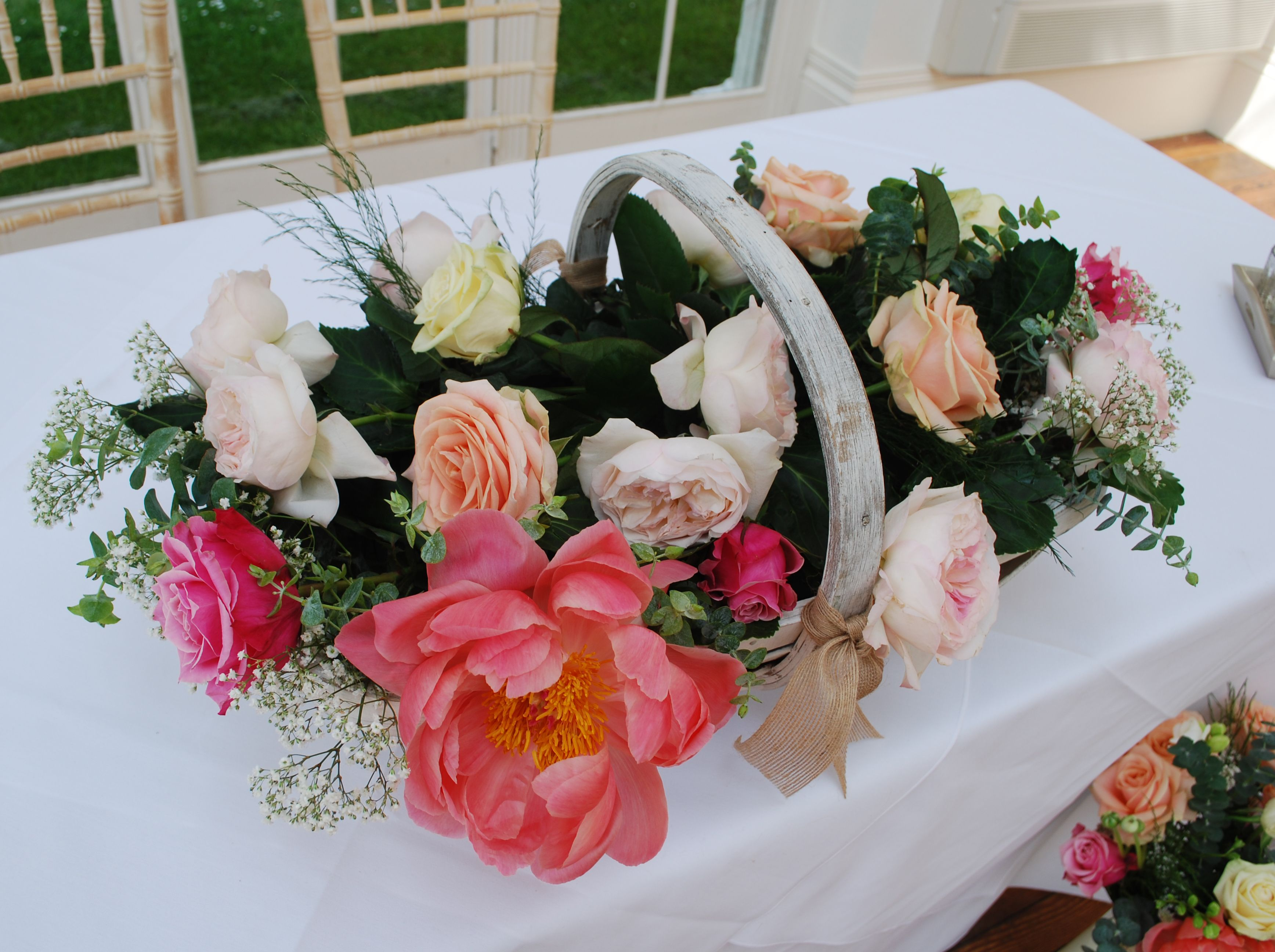 Trug of flowers for the wedding at Barton Hall Orangery, Kettering, Northants. Beautiful display of peony and roses in the coral and cream wedding theme. www.fieldgateflowers.co.uk