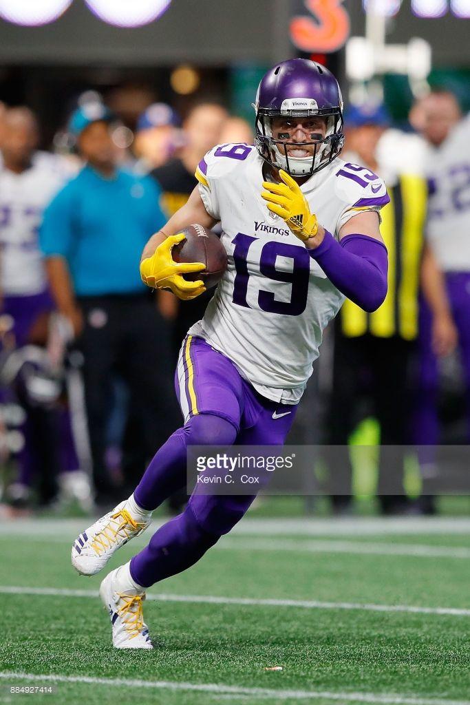 News Photo Adam Thielen of the Minnesota Vikings runs