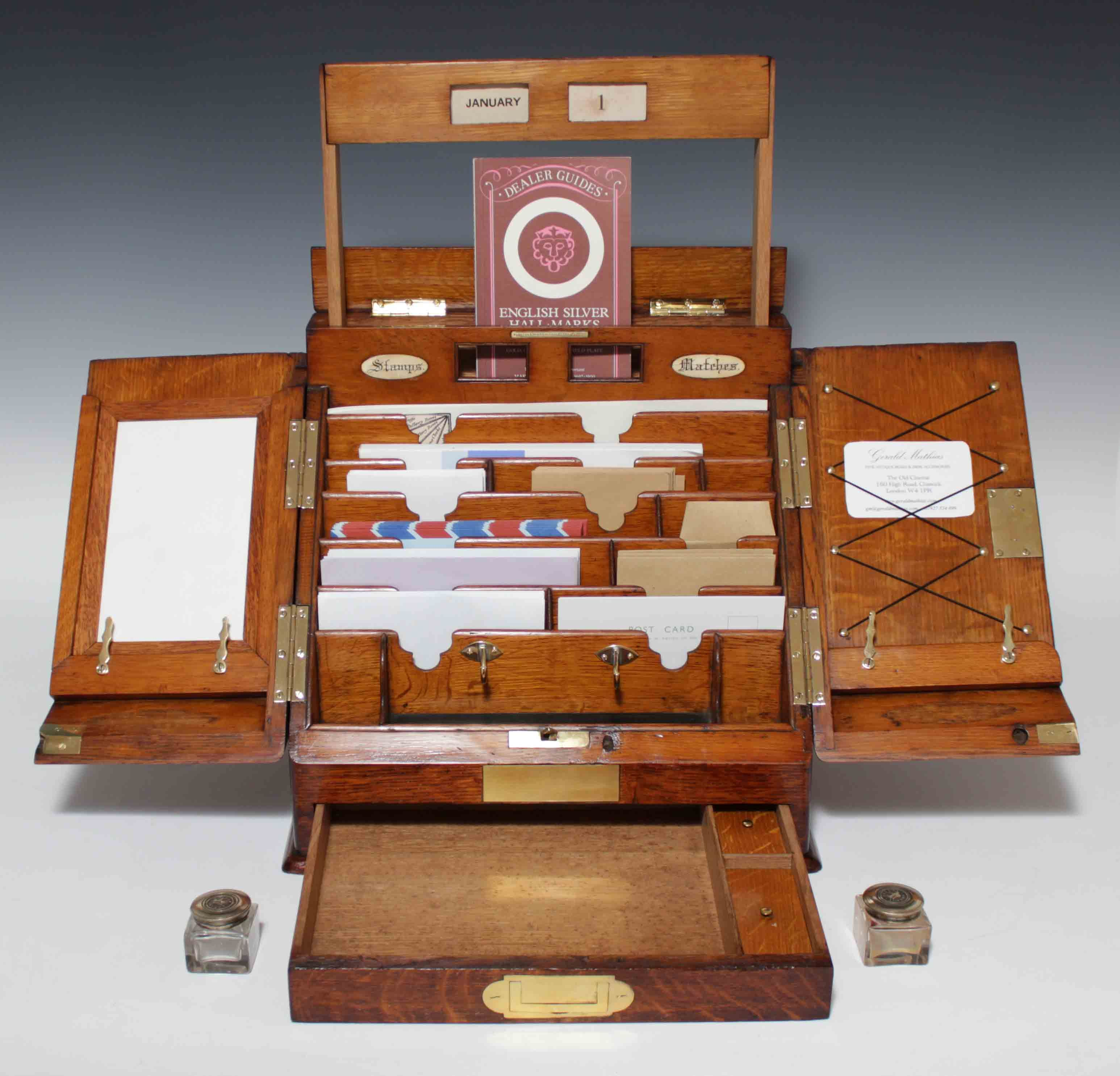 Antique Parkins & Gotto stationary cabinet - A small molded oak ...