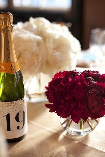 Champagne Bottle Table Numbers And Burgundy Peonies White Peony