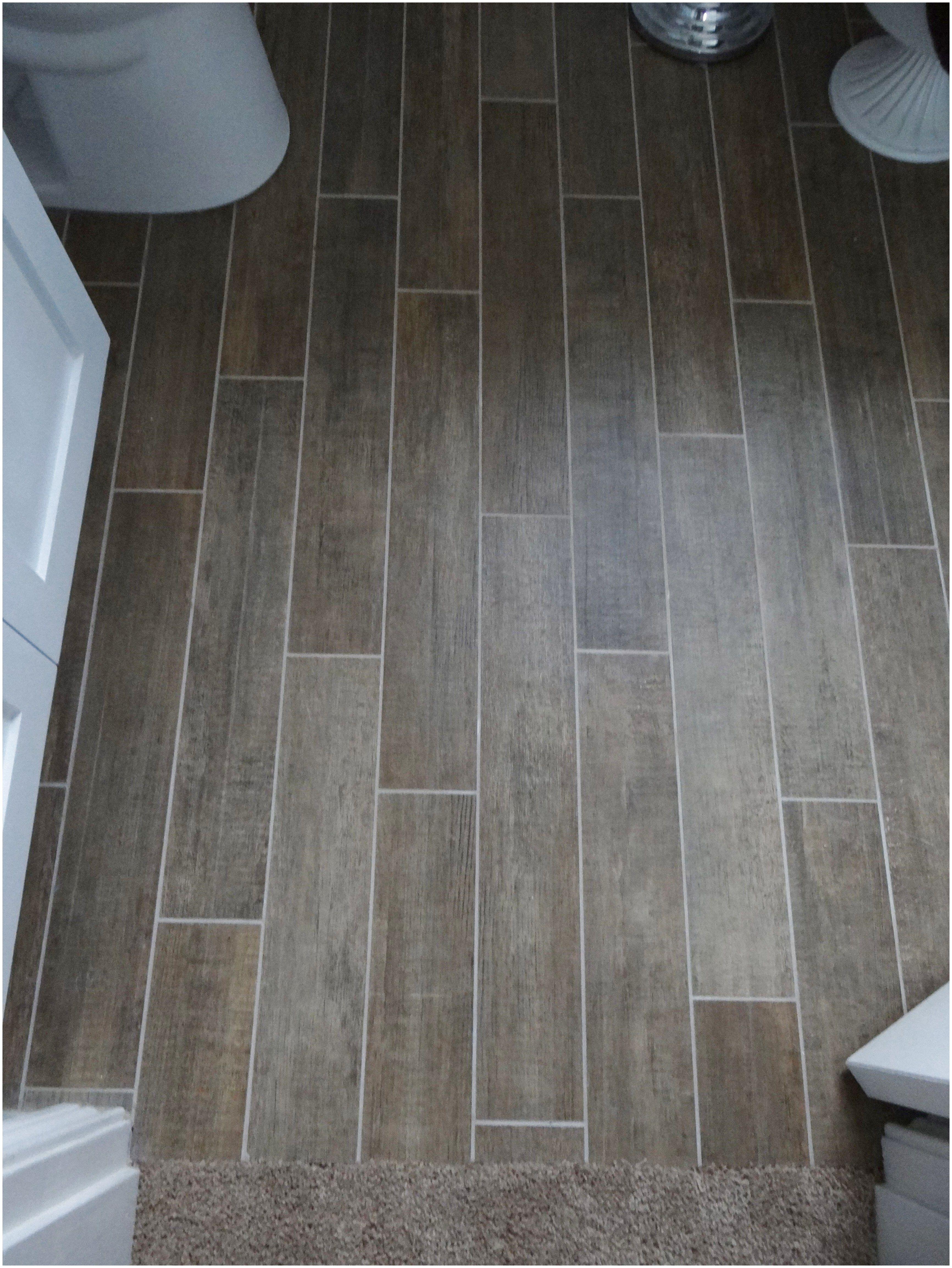 Loving tile floor that looks like wood for the bathrooms