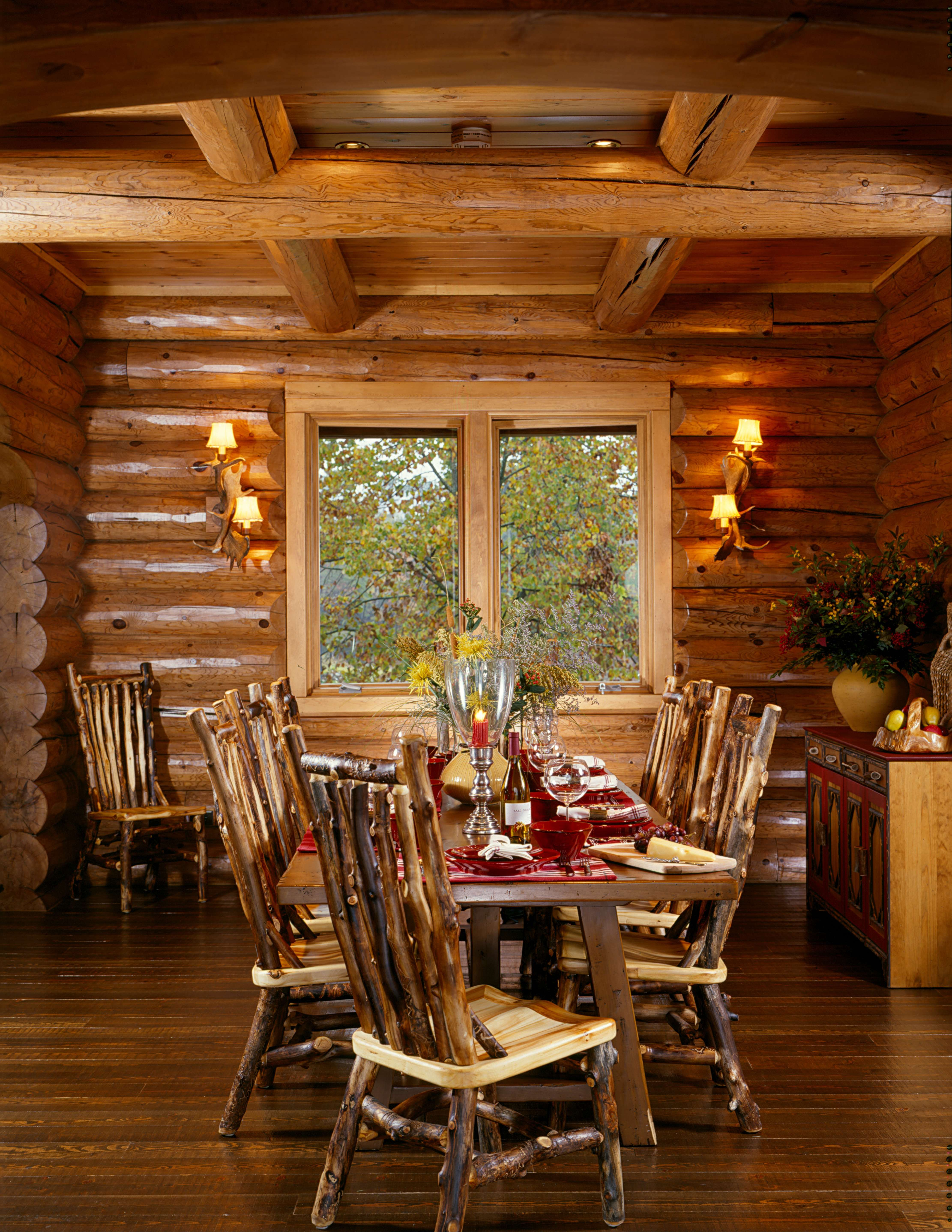 Beautiful, Rustic Dining Room By Hiawatha Log Homes.
