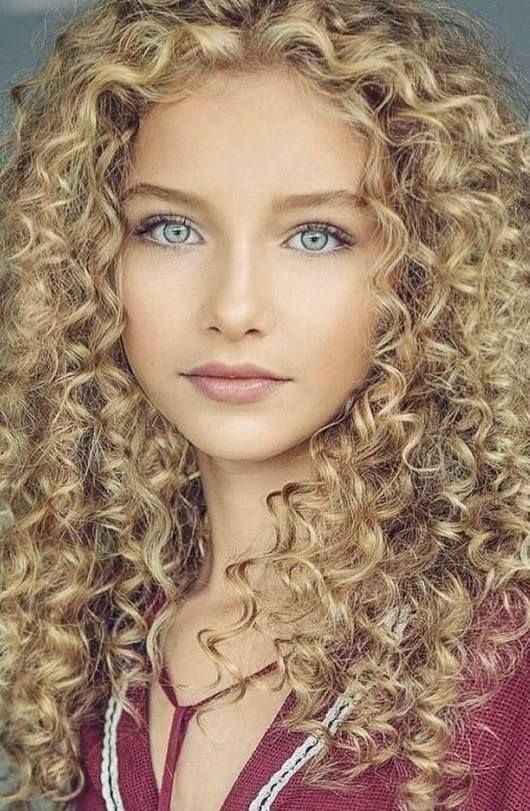 cute curly blonde with pretty blue
