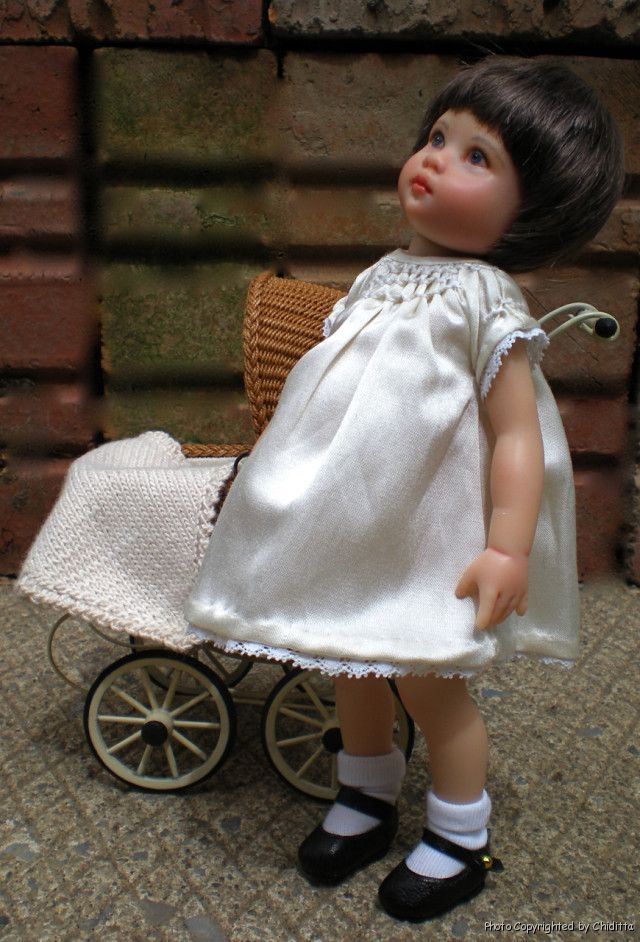 Dorothy06 by artist Nancy Lee Moran 2010, repainted doll Riley Kish as 1920s American girl, dress sweater coat by Chiditta, Boneka leather shoes, buggy by Marie Terrones of Wickerville, tiny doll by Jenna of Rasbubby Hill
