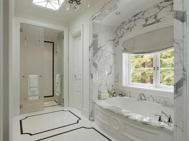 Bath Marble impressive marble bath nook features a curved wainscoted tub
