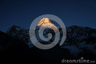 Amazing light on Ama Dablam peak during sunset.