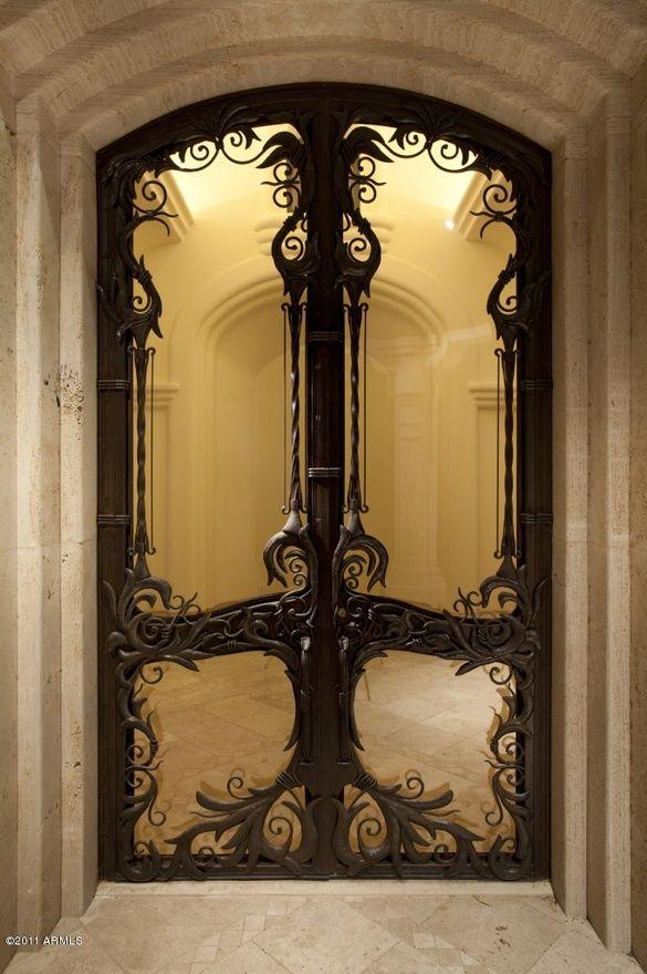 Art Nouveau iron and glass door