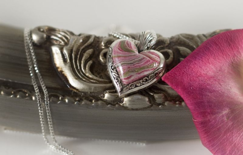 take flowers from your wedding and have them preserved and used to make a pendant