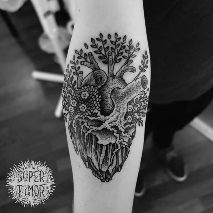 Poetic tattoo by Super Timor.