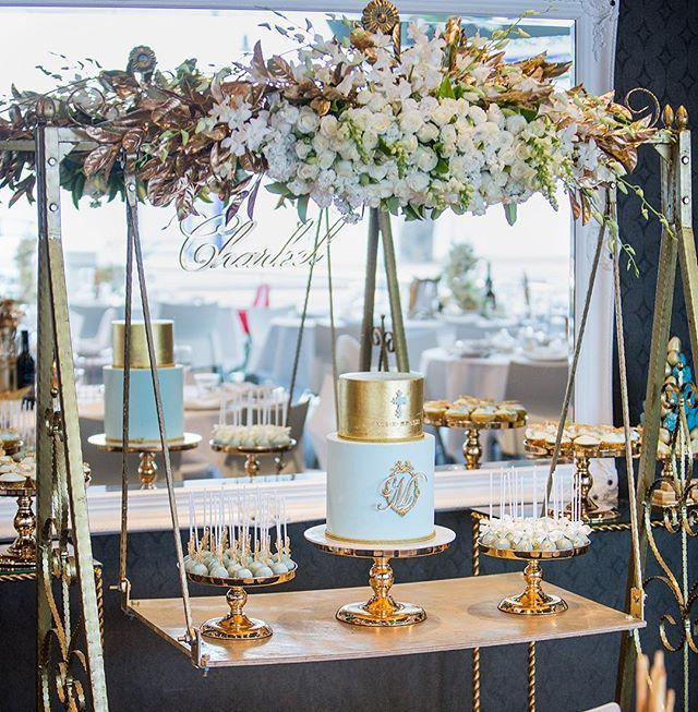 A Beautiful Cake Display With Gold Cake Swing Rope Gold Table And