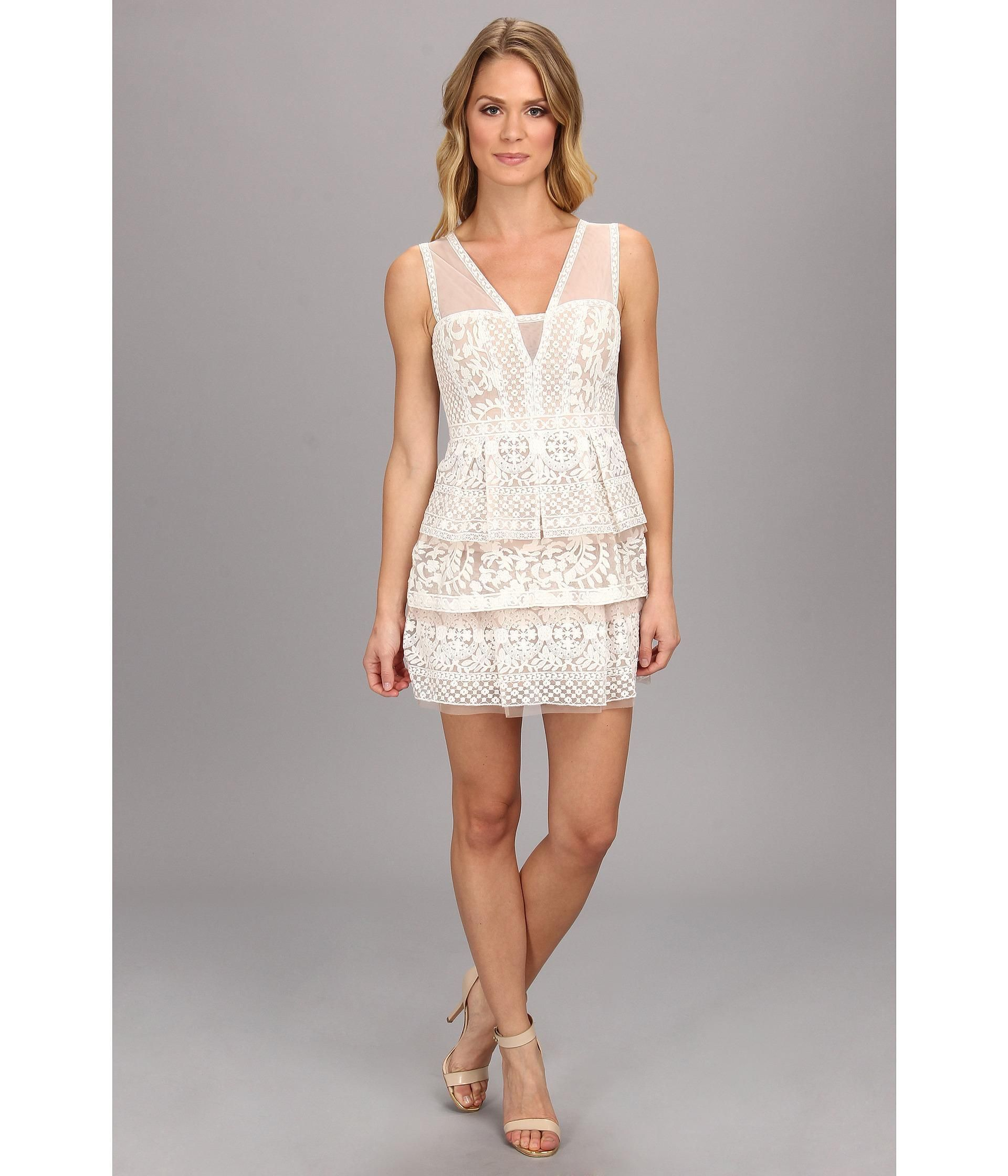 Sleeveless engineered lace dress flaunts tulle trim at tiered skirt