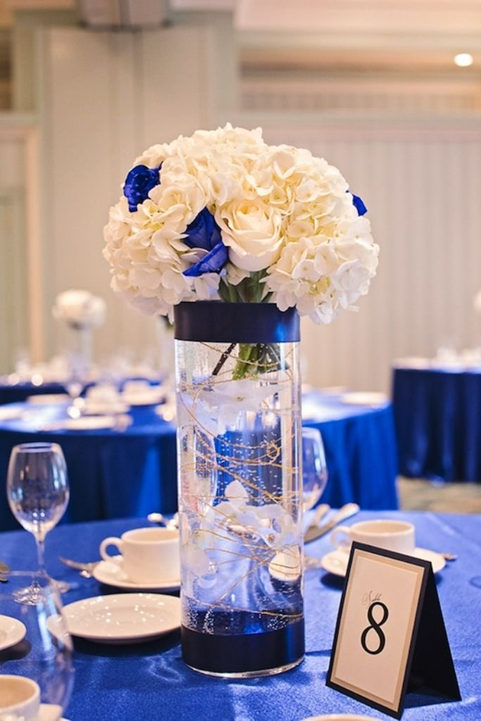 - Blue and white centerpieces ...