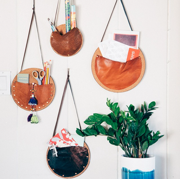 wall pockets made of cork and leather scraps