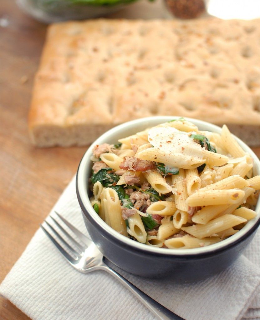 Tuna, Spinach & Bacon Penne    Serves 4    adapted from Earthbound Cook     1 box penne ( 1 pound)     4 slices of bacon, chopped     2 T olive oil     2 scallions, sliced     3 garlic cloves, minced     1/2 cup chicken broth or white wine     2 cans, tuna in olive oil, drained     1 pound fresh spinach, washed and dried    salt and pepper     grated Parmesan to taste     drizzle of Black Truffle oil     Red chili flakes, to taste
